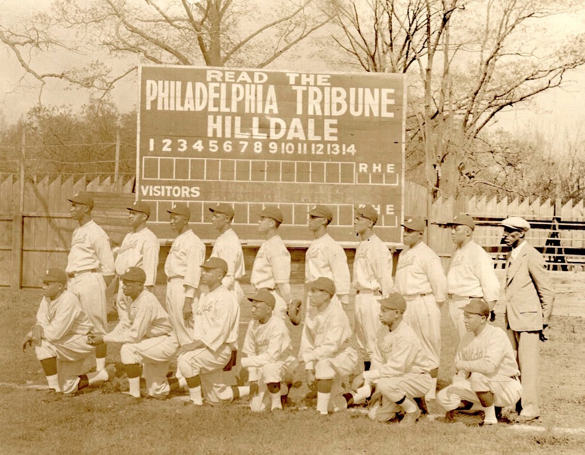 "Hilldale baseball team in front of ""Read the Tribune"" scoreboard, circa 1925"